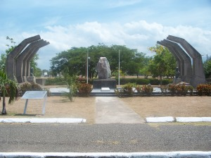 According to the Jamaica National Heritage Trust, the arches of the monument are symbolic of ten fingers and the finish of the arches has been roughened to symbolize hands that toiled during slavery; the centerpiece, a natural Jamaican marble boulder, is a symbol of freedom.