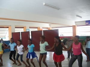The young girls do an African dance demonstration in the dance studio on the third floor of the facility.