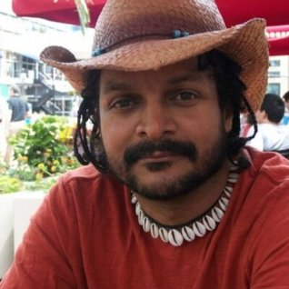 tony_medina_with_straw_hat_photo_400x400